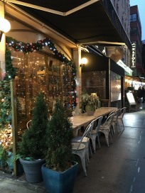 Beautiful sidewalk dining in Little Italy.
